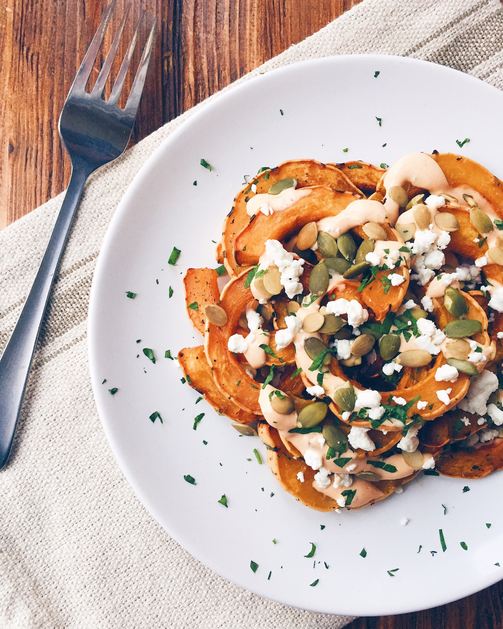 Roasted Delicata Squash With Goat Cheese, Pumpkin Seeds and Jalapeño Yogurt Sauce