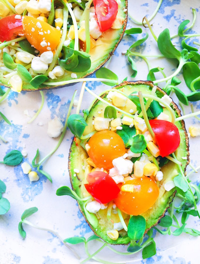 Stuffed Avocado with cherry tomatoes, goat cheese and fresh corn