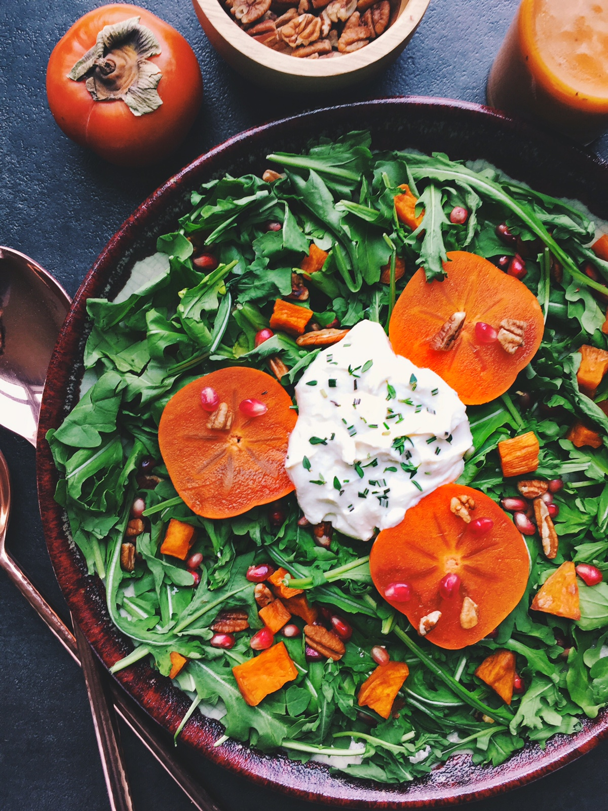Fall Harvest Salad with Pumpkin Vinaigrette | A Pinch of This | Healthy vegetarian salad filled with sweet potatoes, persimmons, pomegranate seeds, toasted pecans, honey whipped ricotta and arugula. Perfect for Thanksgiving.